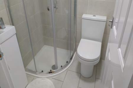 Image of plumbing in a shower installation.