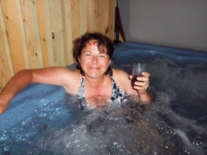 Image of a lady enjoying a hot tub or jacuzzi.
