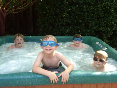 Image shows children enjoying a hot tub.
