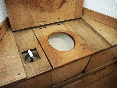 Image shows an early example of a toilet and how a toilet works today is still very similar..